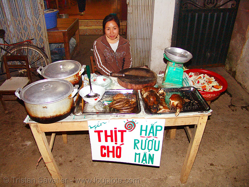 cooked dog meat food stall - thịt chó - Hấp Rượu Mận, butcher knife, carcass, cooked dog, cooked meat, cooking pots, dog meat, food dog, lang sơn, scale, stall, street market, street vendor, table, woman