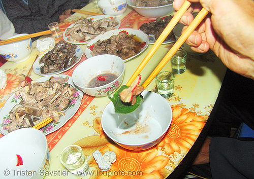 dog meat dinner - eating a bit in a leaf - thịt chó - vietnam, chopsticks, cooked dog, dinner, dish, food dog, meat, vietnam