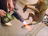 dog meat - singeing, burned, burning, butcher, carcass, dead dog, dog meat, dog paws, fire, flames, food dog, grilled, roasted, singeing, torch